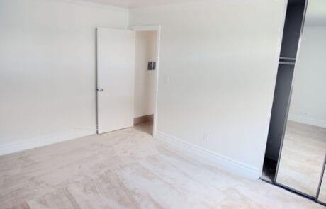 Tustin Apartments - Las Casas Apartments - Spacious Bedroom With Cozy Carpet, and Mirror Sliding Door Closet