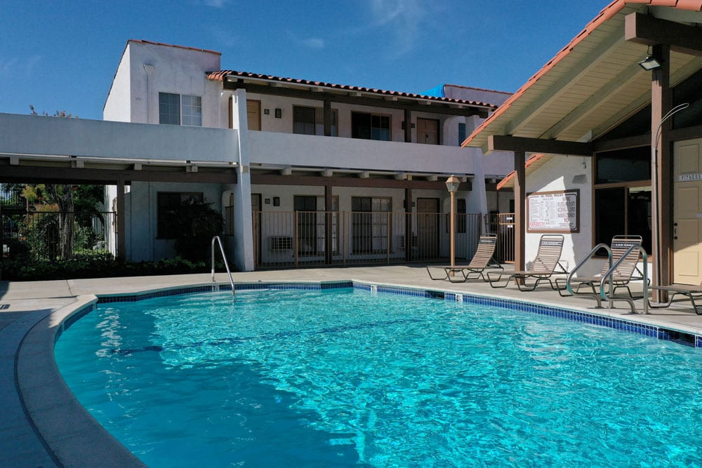 Apartments for Rent in Tustin - Las Casas Apartments -Sparkling Swimming Pool Surrounded by Lounge Chairs